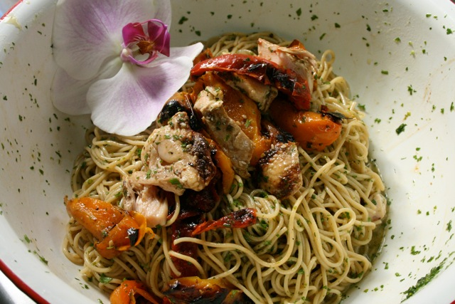 Asian Noodle Salad up close with grilled chicken and orchid