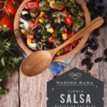 Summer Salsa in wood bowl with wood spoon on wood table with kitchen towel tall pin