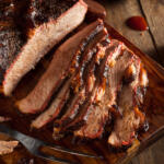 Simple Brisket Recipe with Onion, Garlic and Spices Made in the Crock Pot. Easy, Tender, Delicious.