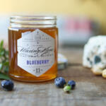 Blueberry Honey with Blue Cheese and fresh blueberries on the dock on the eastern shore for National Blueberry Month