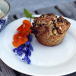 Gluten Free Bran Muffin made with honey on plate with fresh flowers on pier