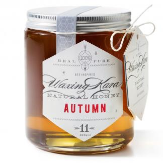Jar of Waxing Kara Autumn Honey on white background