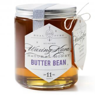Jar of Waxing Kara Butter Bean Honey on white background