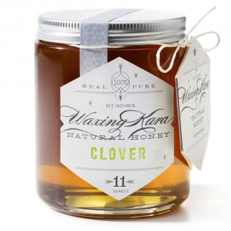 Jar of Waxing Kara Clover Honey on white background