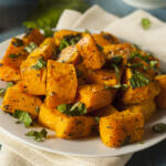 Honey Glazed Roasted Butternut Squash Recipe on plate garnished with chopped parsley