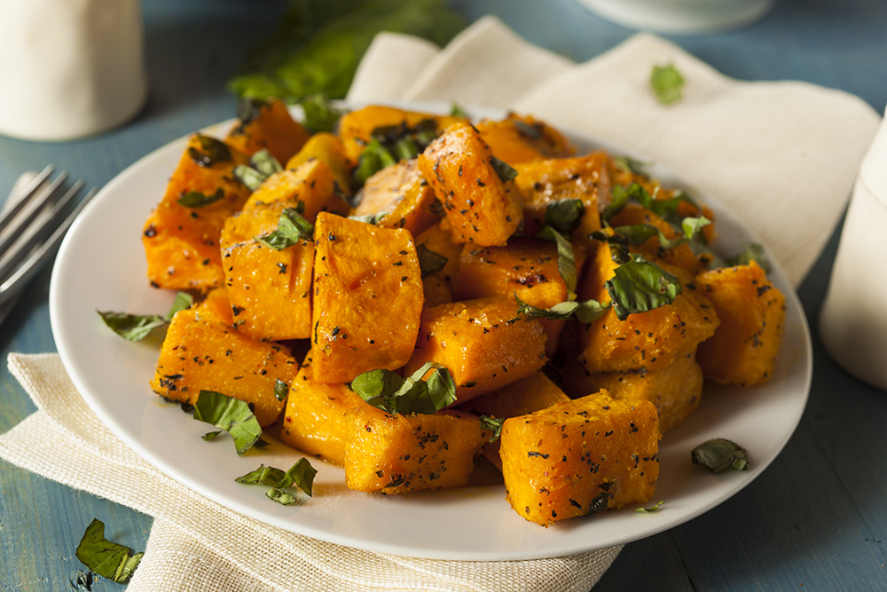 Honey Glazed Roasted Butternut Squash on plate garnished with chopped parsley
