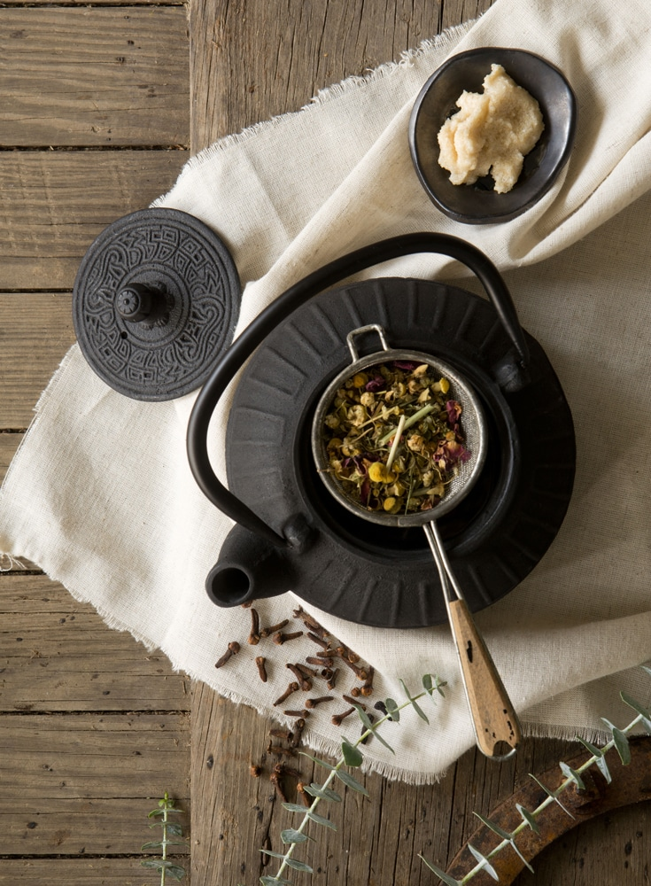 Teapot with botanicals of Lavender Chamomile Tea being made