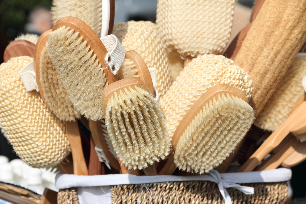 a collection of dry brushes to encourage dry brushing skin