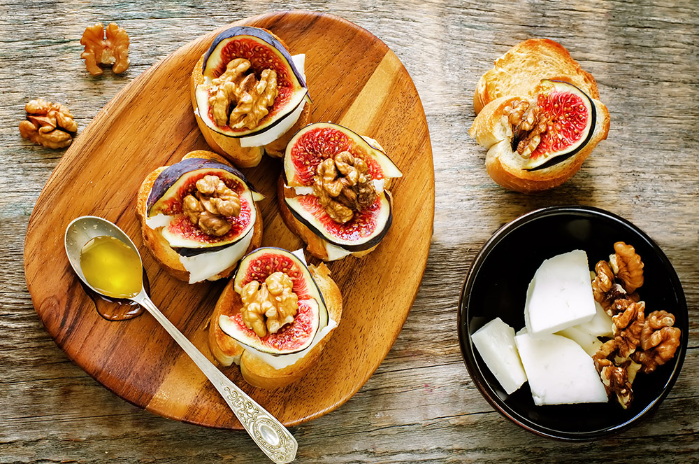 Try goat cheese and fig crostini as appetizer in your next summer garden party.