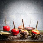 National Dessert Day recipe featuring chocolate sticky apples on grate, dipped in nuts