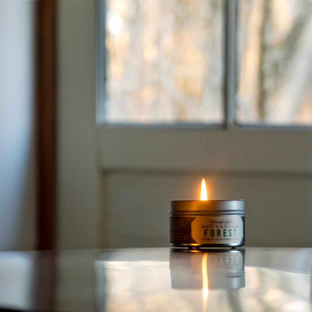 soy tin candle on the set