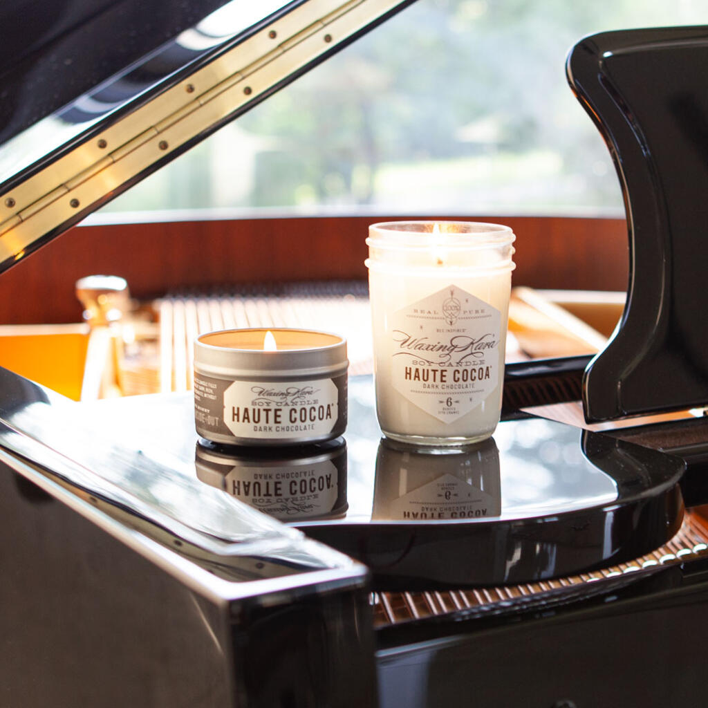 Haute Cocoa Candles on piano