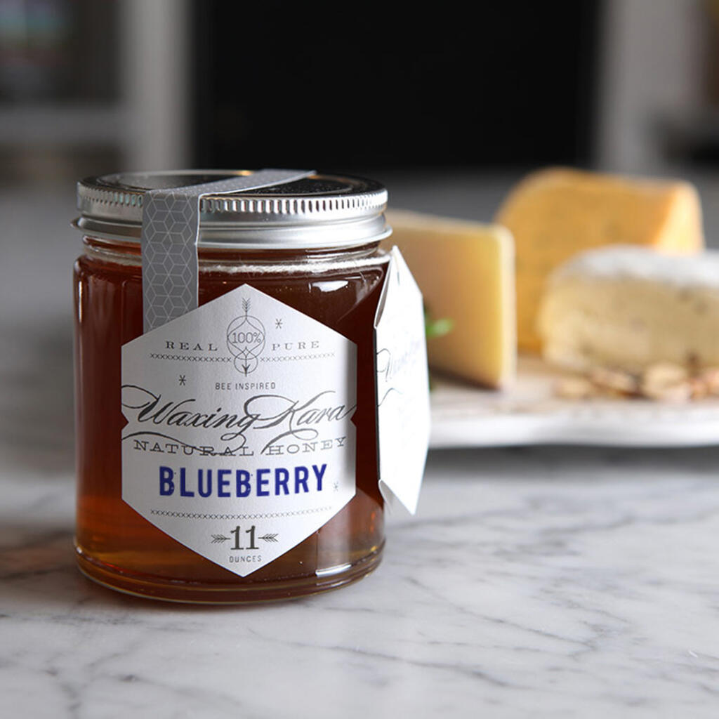 father's day gifts of blueberry honey on table with cheese