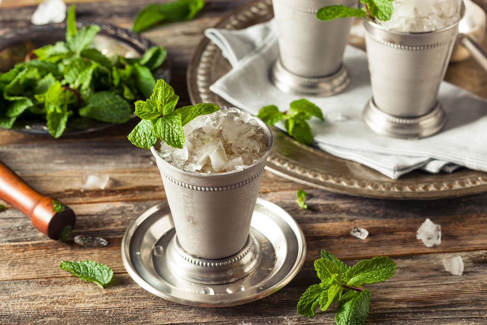 Mint Julep with Honey in silver cup on table