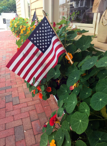 Happy Independence Day small american flag in window planter box in St. Michaels Maryland