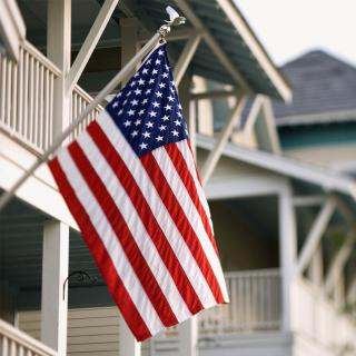 Image of flag on beach house National Flag Day and Veterans Day