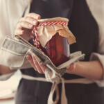 Woman holding strawberry jam with apron