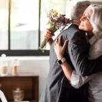 Parents of the Bride in receipt of wedding gifts for parents and embracing