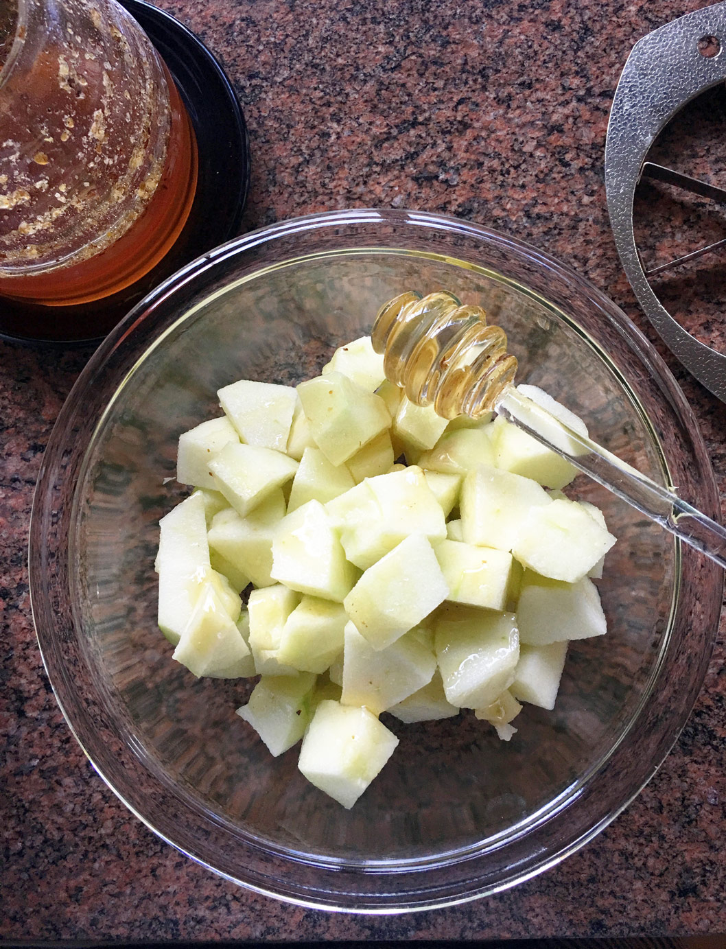 Bowl of fresh-cut granny smith apples on the kitchen counter