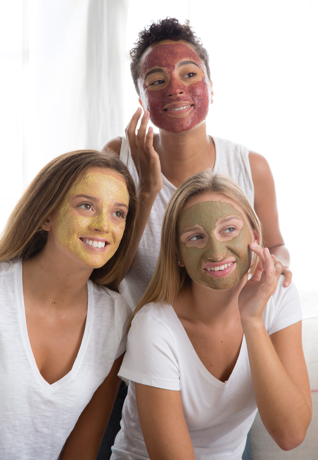 Girls using Harvest, Sea and Tea, and Bee Inspired face masks.