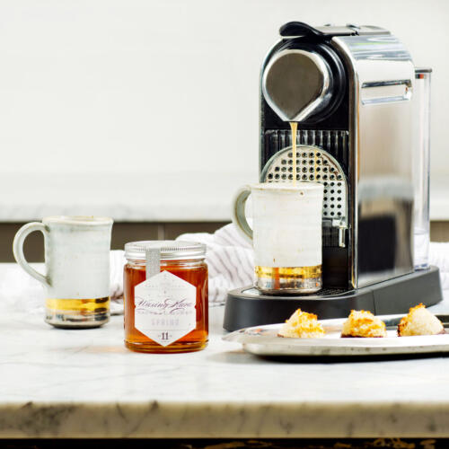 Coconut Macaroons and coffee maker on kitchen counter with our Spring honey from Chesterhaven Beach Farm