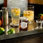 Drink setting for eastern shore honey vodka including shaker, tray and fruit