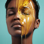 Honey Skincare Model with eyes closed and a jar of honey on her face