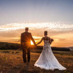 Wedding Season Honey Gifts bride and groom on the farm walking into the sunset