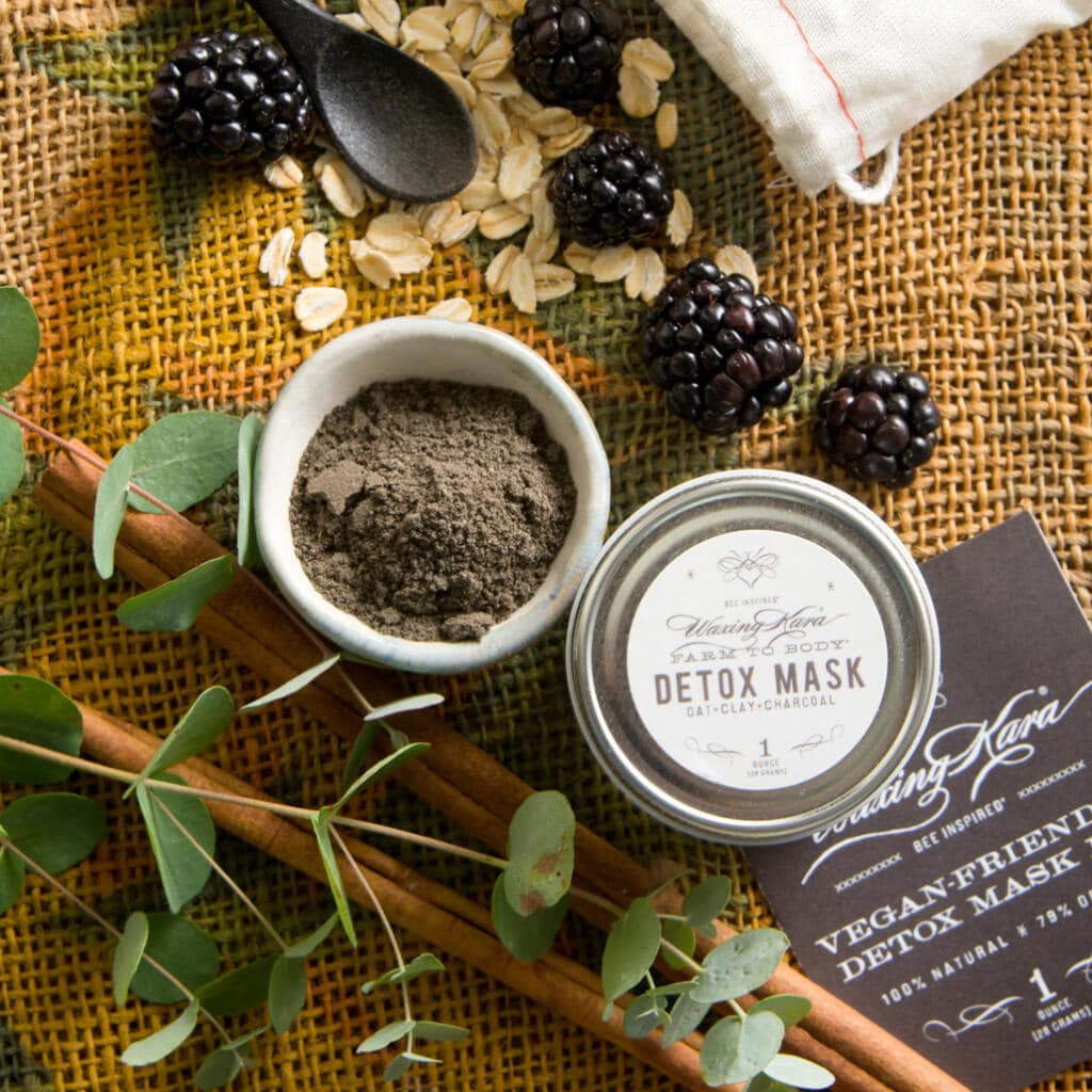 Detox Mask along with raw ingredients, open to show color and texture with hangtag on burlap
