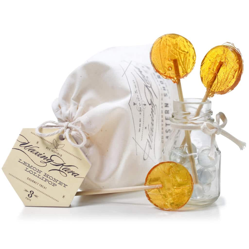 honey lemon lollipops with bag and tag on white