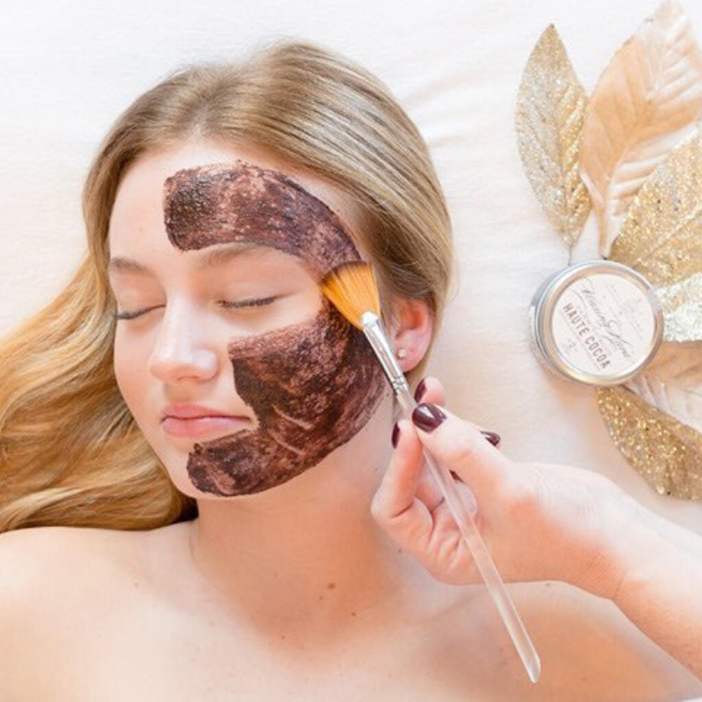 Haute Cocoa Mask being applied with a makeup brush