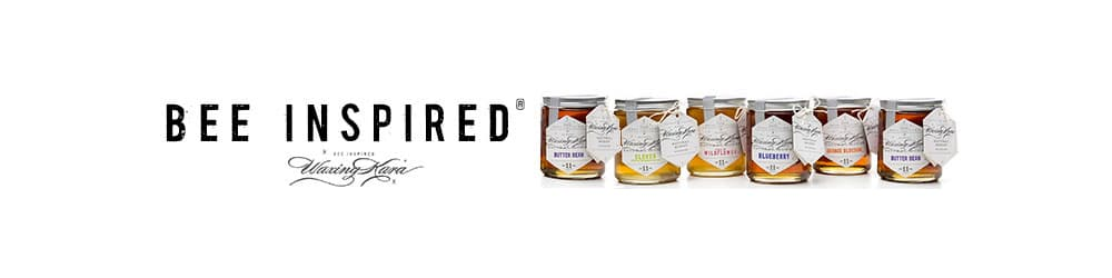 bee inspired ad with registered trademark and waxing kara honey jars in a row