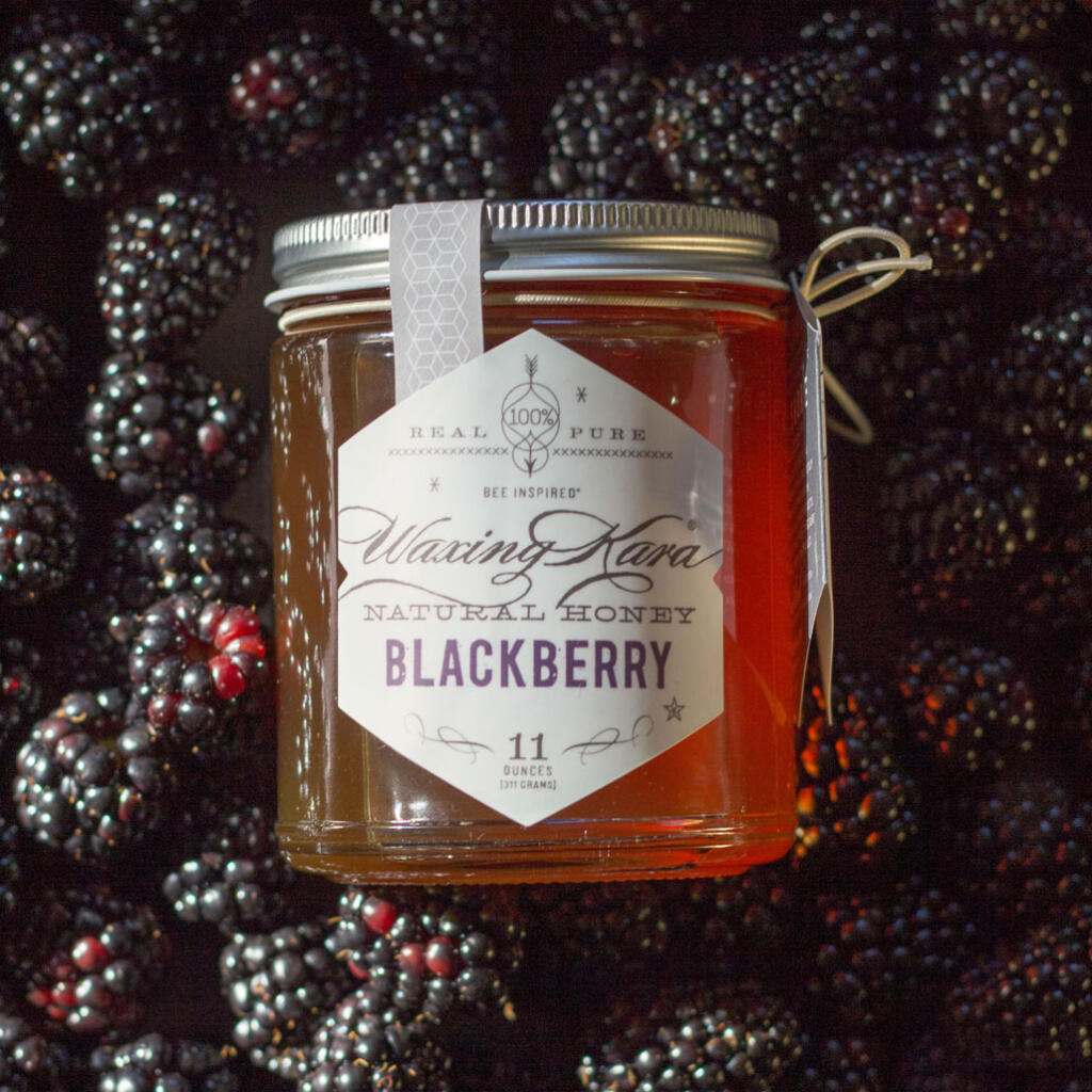 Blackberry Honey in a bed of berries