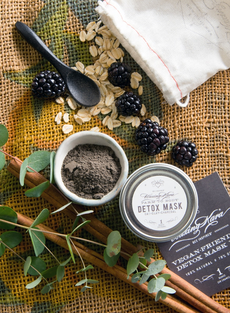 Detox Mask overhead with blackberries, oats, eucalyptus, and botanicals.