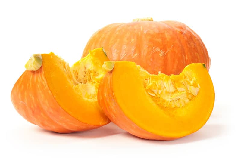 Picture of sliced pumpkin on a white surface