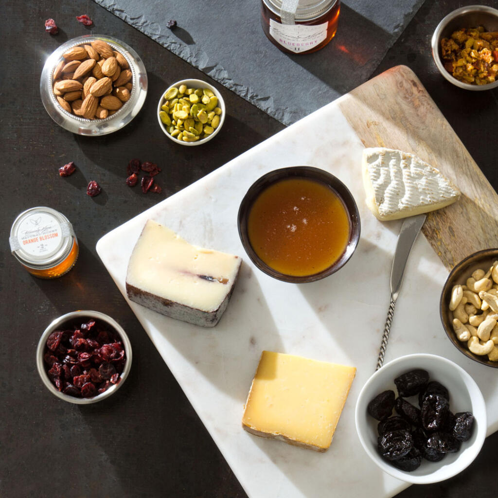Overhead view of a honey and cheese platter shot on location at Chesterhaven Beach Farm
