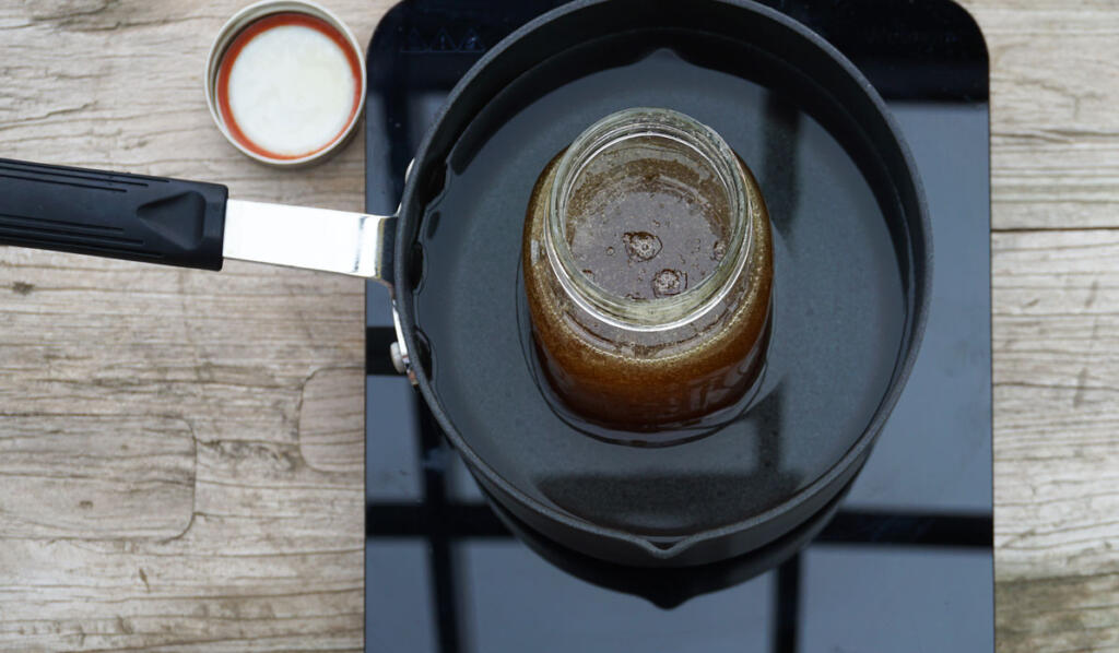 crystallized honey in saucepan on cooktop on wood table at chesterhaven beach farm