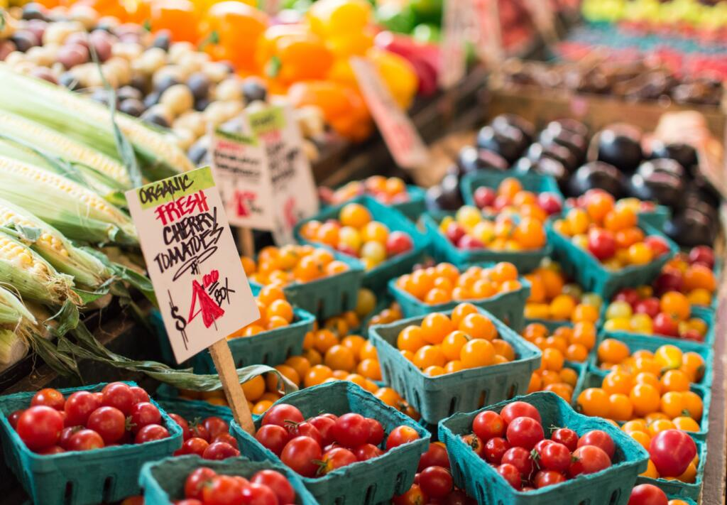 Heirloom cherry tomatoes at the farmers market in every color