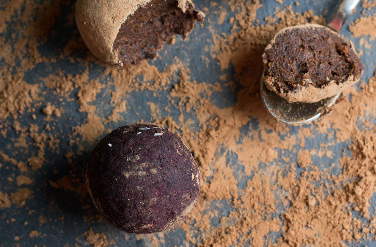 chocolate truffles on slate with cocoa powder