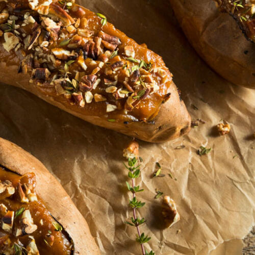 stuffed sweet potatoes on parchment with fork