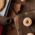 holiday cookie recipes in the making on wood table with berries