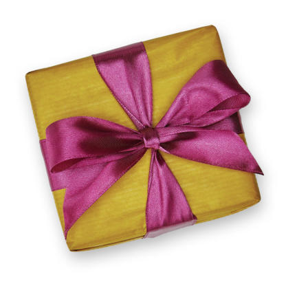 A wrapped gift box with a bright ribbon and bow